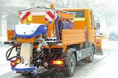 foto of spreader  - Snow plough truck with salt and grit spreader