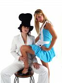 stock photo of mad hatter  - Alice in Wonderland and the Mad Hatter girls in costumes - JPG