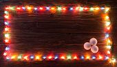 Christmas Light Decorations On Wood Texture poster