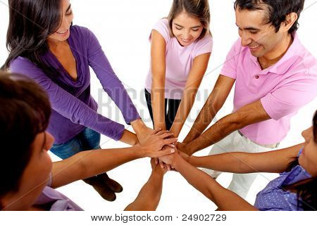 Young people with their hands together in the middle ? teamwork concepts