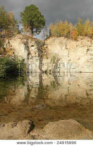flooded stone quarry at autumn time  - Zulova - Jesenik mountains - Czech republic