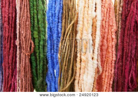 Wall of many colors of raw yarn for sale