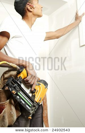 Portrait Of A Man Drilling Into A Wall