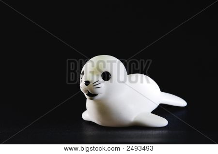 Baby Seal Toy Over Black