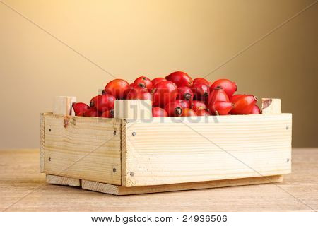 ripe briar in wooden box on wooden table on brown background