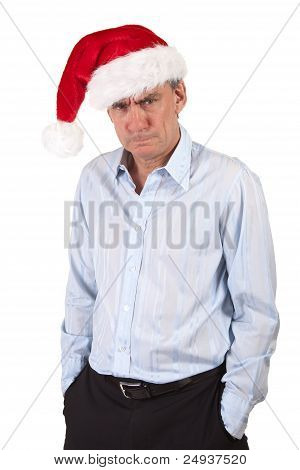 Grumpy Frowning Angry Business Man in Christmas Santa Hat Bah Humbug