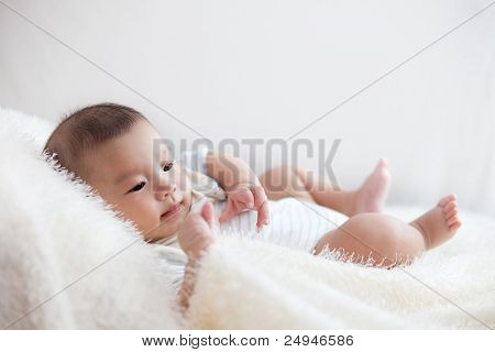 cute baby lie on bed