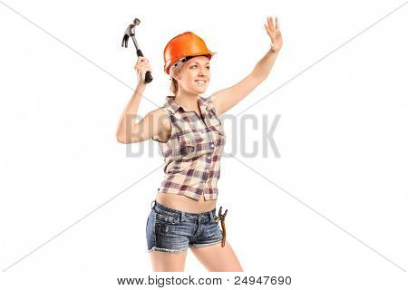 Female manual worker with hammer isolated against white background