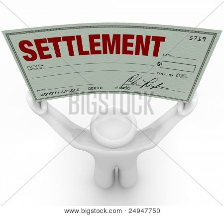A man holds a large settlement check that he has won in a trial in civil court proceedings after the other party agreed to settle the case