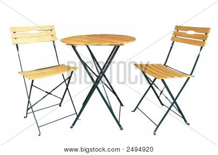 Wooden Slat Chairs And A Table