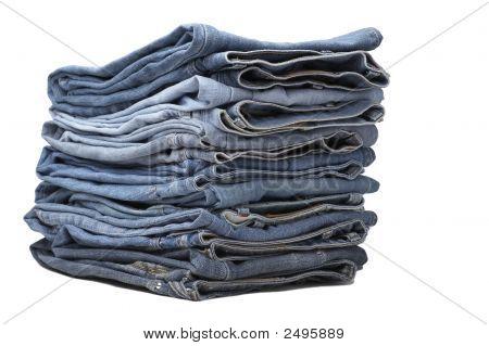 The Heap Of Modern Designer Blue Jeans