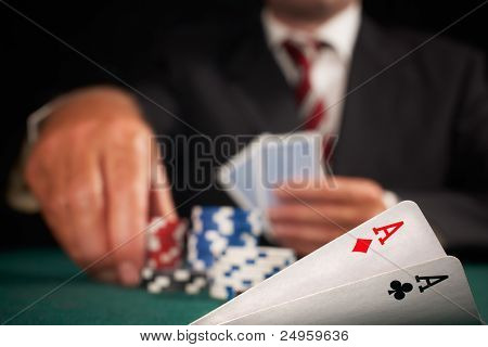 Pair Of Aces And Poker Player