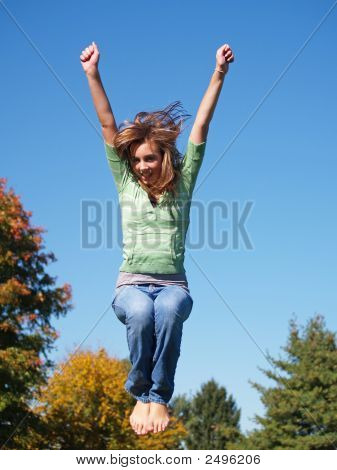 Teenage Girl Jumping In The Air