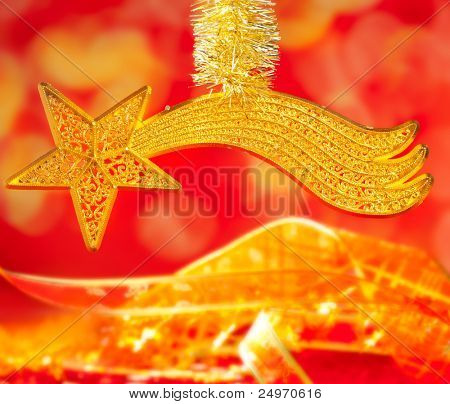 Christmas card bethlehem comet gold star on red blur background