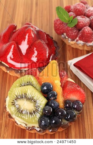 Fresh fruit pie tarts on display.