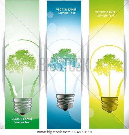 Tree in a light bulb, banners with eco energy symbol.
