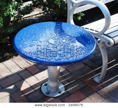 After A Rain. Street Little Table.