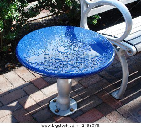 After A Rain. Street Little Table.