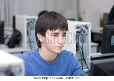 The Student Works With A Computer At University