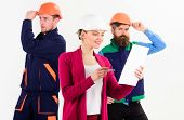Female Boss Concept. Woman In Hard Hat With Busy Face Manages Mens Team Of Builders, Defocused. Team poster