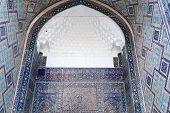 picture of mosk  - Arch of Tilya Kori Madrasah from courtyard in Samarkand Uzbekistan - JPG