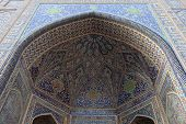 stock photo of mosk  - Gate of Sher Dor Madrasah from courtyard Samarkand Uzbekistan - JPG