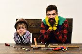 Father&son Repairing. Son Helps Father. Dad And Son In Workshop. Repair&workshop Concept. Little Ass poster