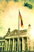 Bundestag In Berlin With The National Flag Of Germany With Patches Of Sunlight, Sunflare. Vintage Vi poster