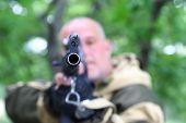 Sighting The Gun Barrel At The Target. The Man Hunter Is Aiming At The Gun. poster