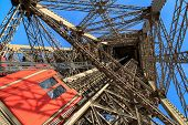 One of the unusual Eiffel Tower lifts that take passengers to the viewing platforms. poster