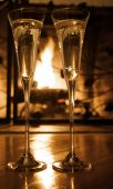 image of champagne glasses  - Champagne glasses with engagement ring in front of the fireplace - JPG