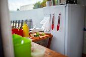While Preparing Delicious Burger In Open Kitchen, Street Food Concept. Street Food Market Vendor. De poster