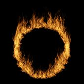 Conceptual yellow orange hot raging blaze of fire, circle round ring flame shape isolated black back poster