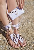 Greek Leather Sandals And White Cotton Bag Advertisement On The Beach - Traditional Greek Leather Sa poster