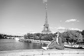 Happy Woman Sit At River On Eiffel Tower In Paris, France. Woman Smile In Sunglasses On Blue Sky. Tr poster