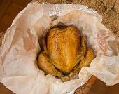 Grilled Whole Chicken With Crispy Golden Skin On White Parchment, Top View, Close-up. poster