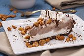 Close Up Of An Ice Cream Pie Dessert. A Studio Image Of A Slice Of Ice Cream Pie Along With Peanuts. poster