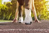 Athlete Woman In Running Start Pose On The City Street. Sport Tight Clothes. Sports Shoes In The For poster