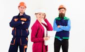 Woman In Hard Hat With Smiling Face Stand In Front Of Male Builders In Uniform, Defocused. Female Fo poster