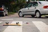 Skateboard And Childs Shoe On A Pedestrian Lines After Dangerous Traffic Incident poster