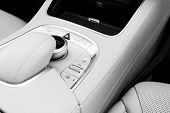 Media Volume And Navigation Control Buttons Of A Modern Car. Car Interior Details. White Leather Int poster