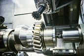 cogwheel on shaft milling process. Industrial CNC metal machining by vertical mill poster