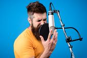 Bearded Man Singing Into Microphone In Recording Studio. Music. Show Business. Recording Studio. Mal poster