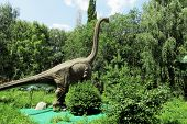 A Huge, Herbivorous Dinosaur In The Forest. A Dinosaur Model In An Amusement Park. poster
