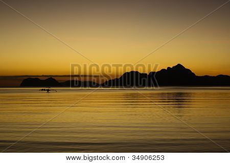 Sunset From El Nido Beach With A Silhoutte Of A Bangka Boat