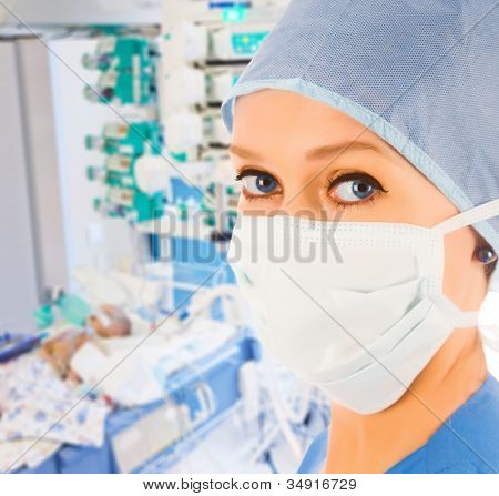 young female doctor in pediatric intensive care unit