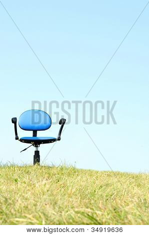 Empty seat on hill with sky