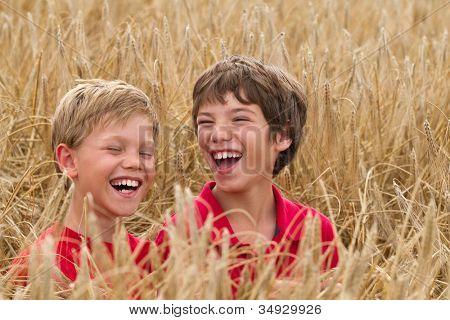 children in a wheat field