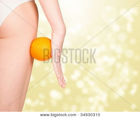 beautiful female figure with orange, golden abstract background with a space for your text or graphics