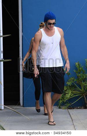 WEST HOLLYWOOD - JUL 13: Miley Cyrus, Liam Hemsworth leaving a Pilates studio on July 13, 2012 in West Hollywood, California